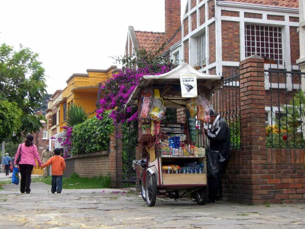 street cart convenience store on residential street of bogota