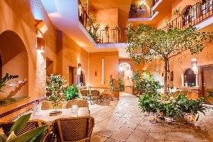 The courtyard of the Hotel Patio de la Alameda in Seville