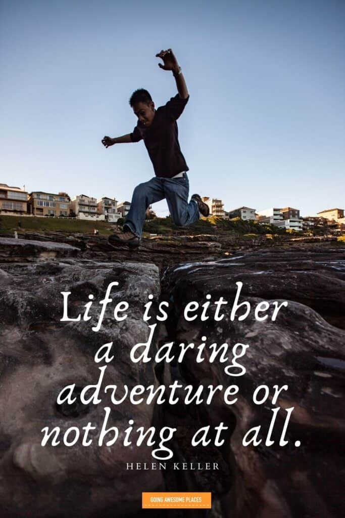 life is either a daring adventure or nothing at all travel quote by helen keller with man leaping over rocks