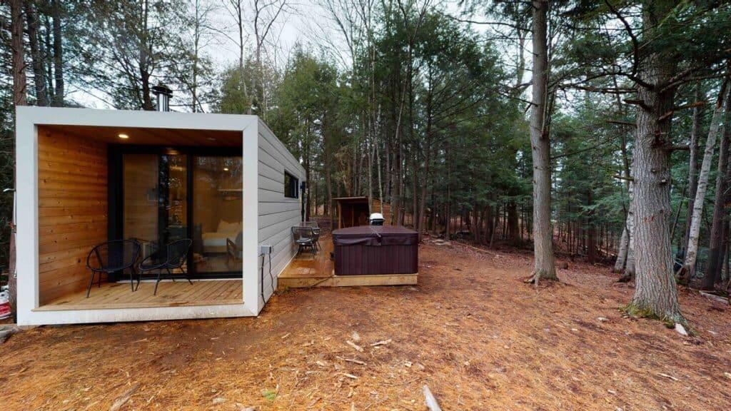 aux box muskoka exterior with hot tub airbnb