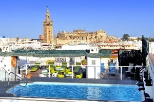 A rooftop pool overlooking Seville, Spain at the Hotel Becquer