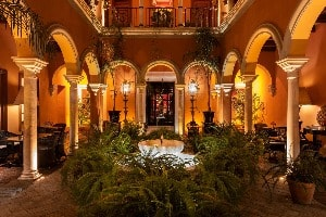 The courtyard of the Hotel Casa del Poeta in Seville lit up at night