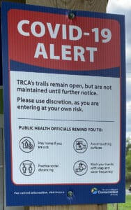 covid-19 alert trca sign along trail