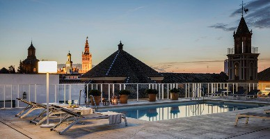 The rooftop pool of the Hotel Fernando III at sunset in Seville