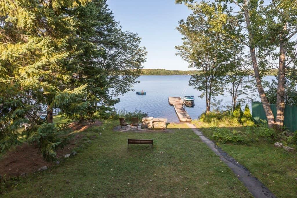 muskoka retreat stewart lake backyard with dock