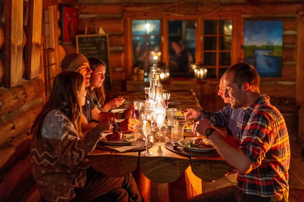 voyageur quest winter log cabin dinner in ontario