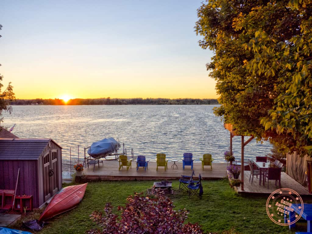 cottage packing list with sunset view of the dock in the summer