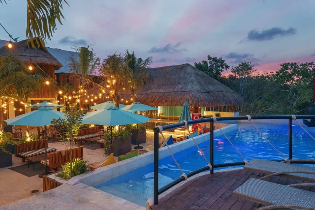 mayan monkey hostel exterior with pool and lounge areas