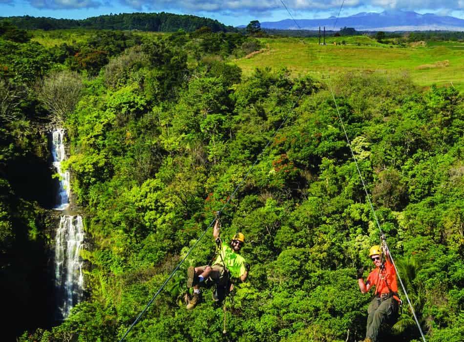 ziplining over kamaeee waterfalls in botanical world adventures