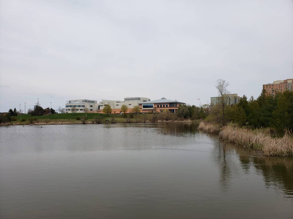 l'amoreaux north park in scarborough with pond and mary ward school behind