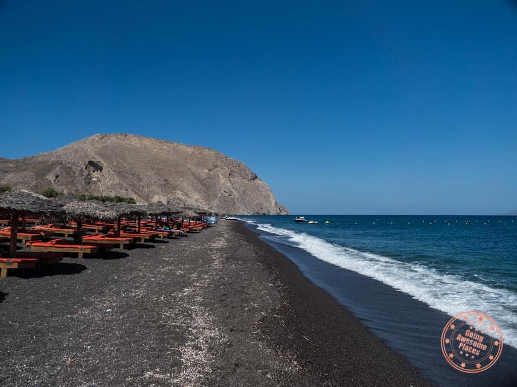 perissa black sand beach in santorini