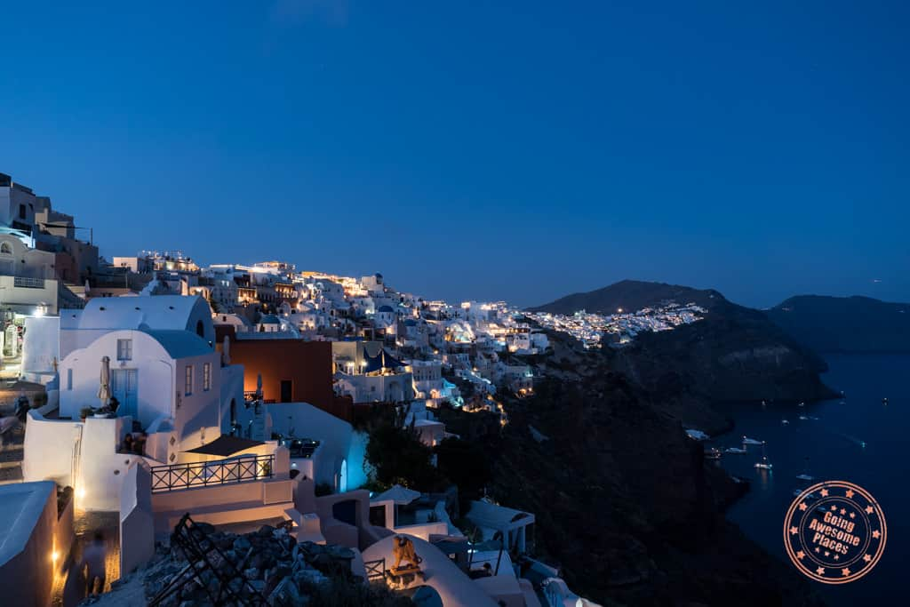 town of oia after sunset with lights
