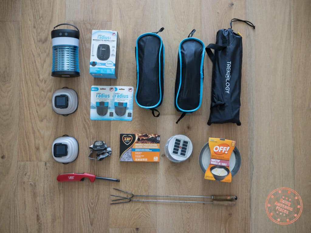camping must haves campsite gear including chairs tables and lanterns