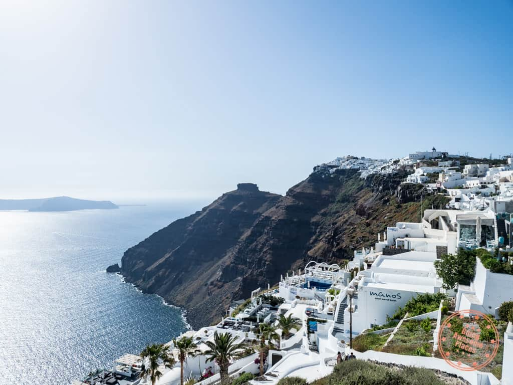 when is the best time to visit santorini with this view of skaros rock from firostefani