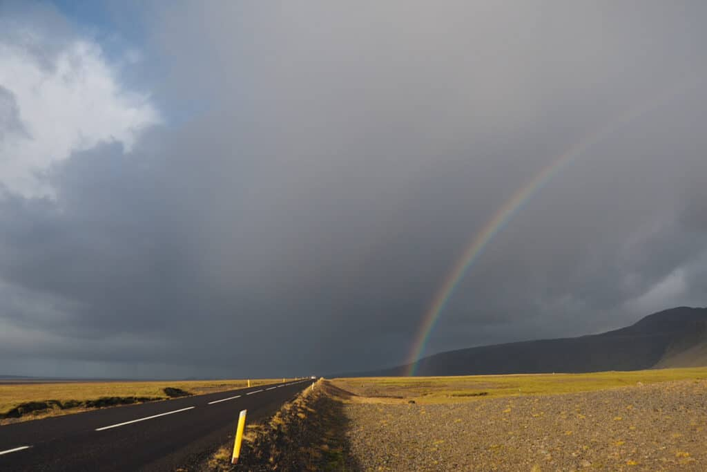 spotting rainbows while driving in iceland on ring road