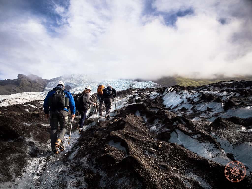 hiking up to falljokull glacier on vatnajokull in iceland