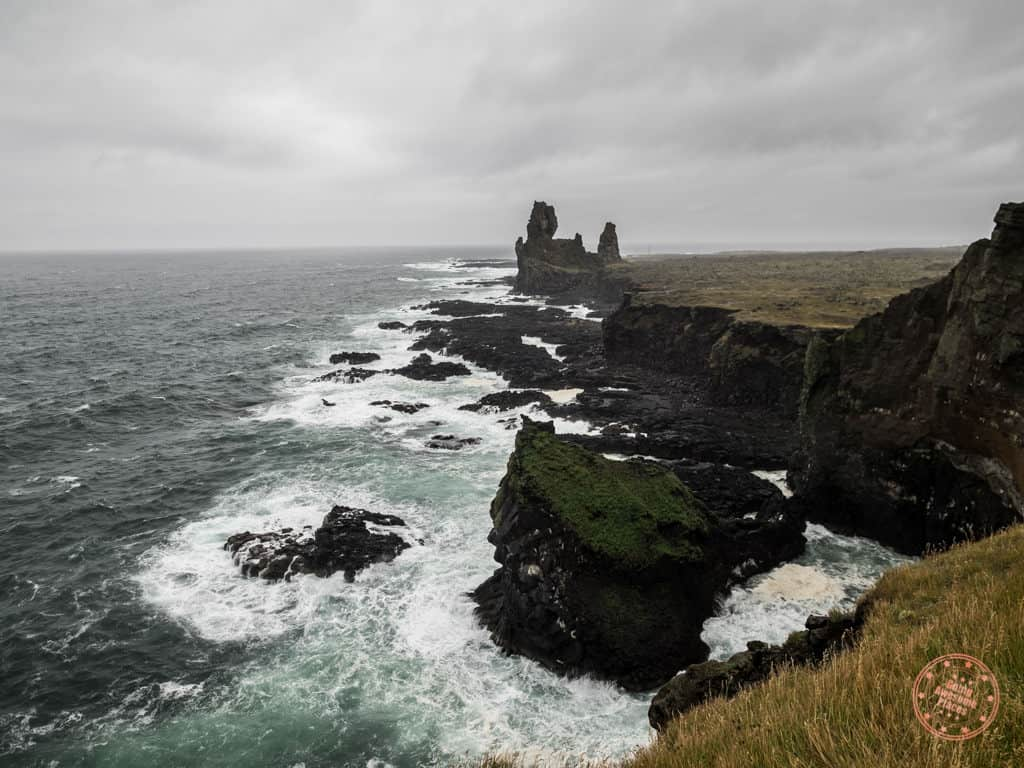 longdrangar on snaefellsnes peninsula in iceland during the shoulder iceland travel season